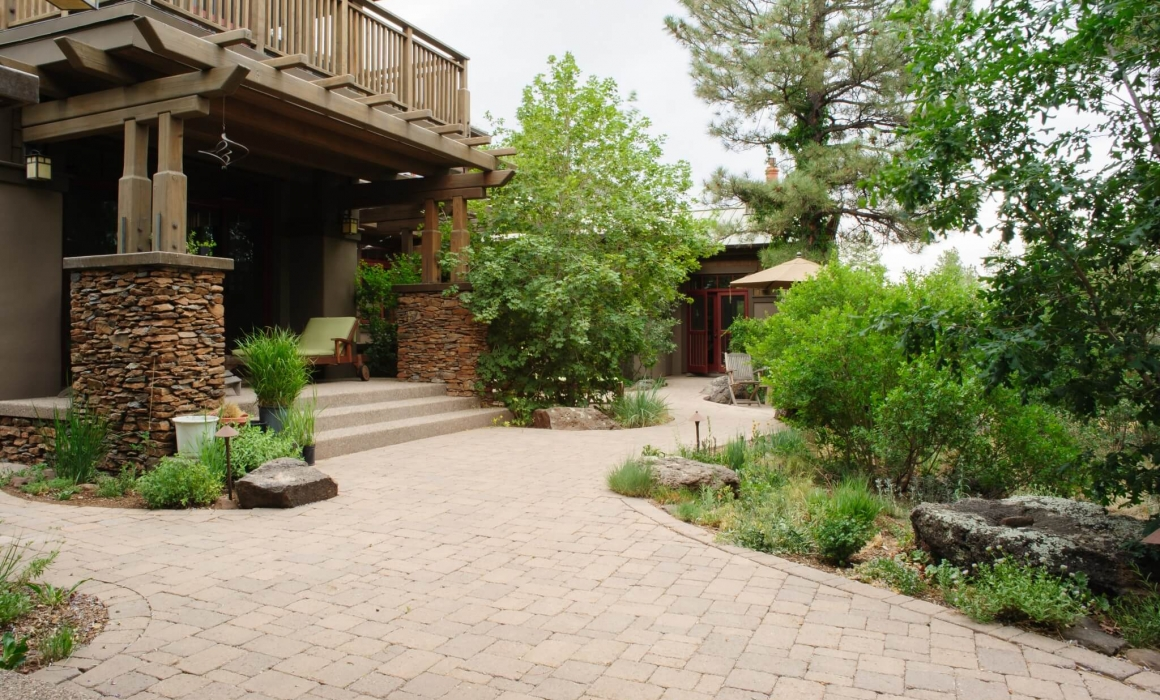 Paver patio and native plant landscape
