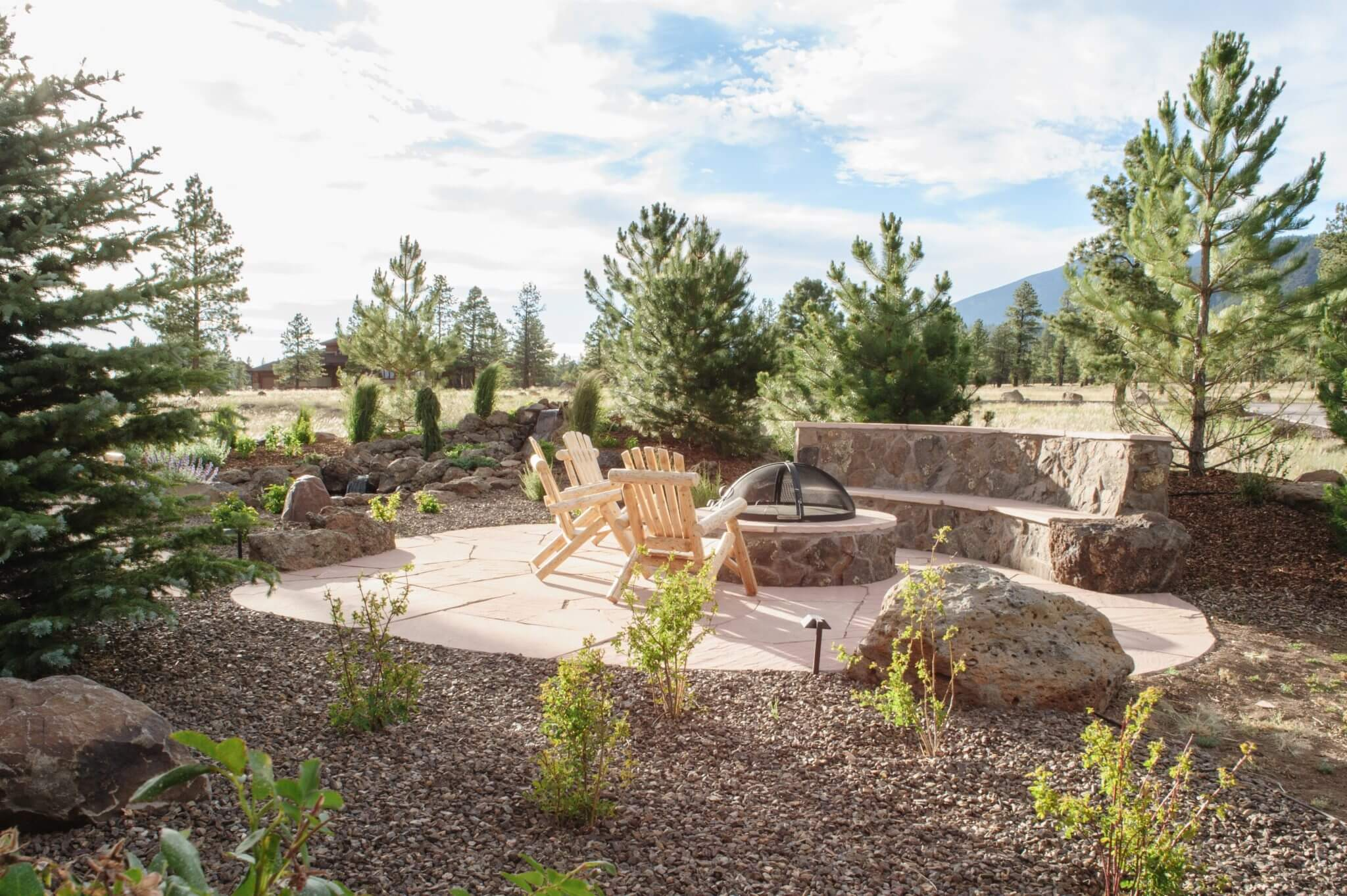 The Brummett Residence- flagstone patio, malapais faced bence seat and fire pit